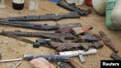 Confiscated weapons are displayed after a military raid on a hideout of suspected Islamist Boko Haram members in Nigeria's northern city of Kano August 11, 2012.