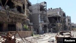 Cảnh tàn phá tại một khu vực trong thành phố Homs của Syria
