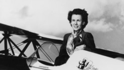 "Betty Skelton poses with her airplane ""Little Stinker."""