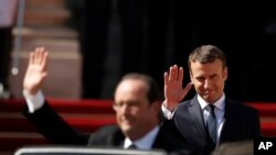 საფრანგეთის ყოფილი პრეზიდენტი, ფრანსუა ოლანდი და ახალი პრეზიდენტი ემანუელ მაკრონი