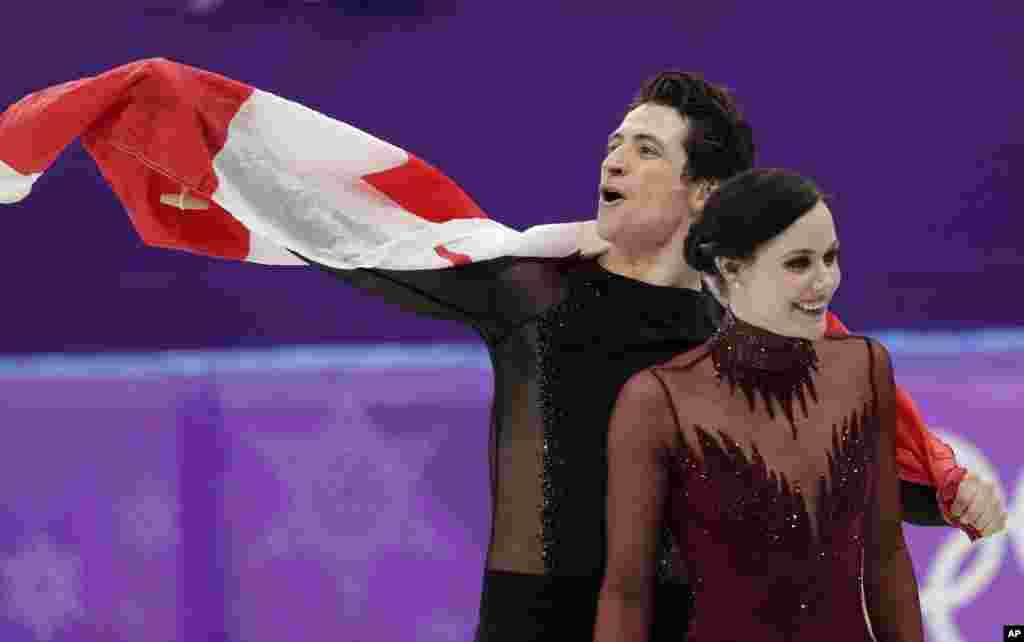 2018年冬季奥运会上,加拿大选手沃尔图和莫伊尔(Tessa Virtue和Scott Moir)2月20日在韩国江陵获得冰舞自由舞滑冰金牌。(2018年2月20日)