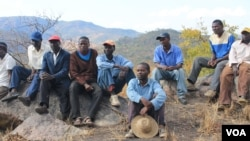 Some MDC-T supporters currently living in a mountainous area in the Muzarabani communal lands, Mashonaland Central Province. They fled their homes after being intimidated by Zanu PF supporters.