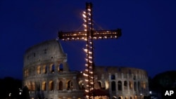 A view of the ancient Colosseum in Rome, April 14, 2017. Pope Francis presided over the Via Crucis (Way of the Cross) torchlight procession on Good Friday in front of Rome's Colosseum. (AP Photo/Alessandra Tarantino)