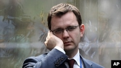 Andy Coulson, former editor of the tabloid News of the World, and later David Cameron's director of communications, speaks on a mobile phone in London, April 13, 2010 (file photo)