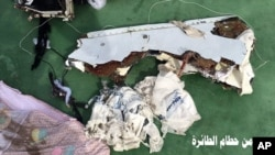 Part of the wreckage and passengers' personal belongings from EgyptAir flight 804 are seen on a photo posted May 21, 2016, on the official Facebook page of the spokesman of the Egyptian Armed Forces.