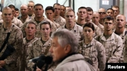 U.S. troops listen to U.S. Defense Secretary Chuck Hagel as he speaks at Camp Bastion, Helmand Province December 8, 2013.