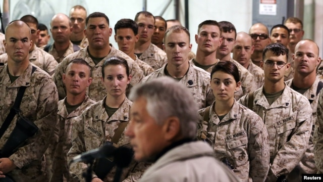 FILE -U.S. troops listen to U.S. Defense Secretary Chuck Hagel as he speaks at Camp Bastion, Helmand Province, December 8, 2013.