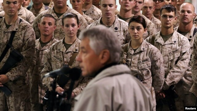 FILE - U.S. troops listen to U.S. Defense Secretary Chuck Hagel at Camp Bastion, Helmand Province, December 8, 2013.