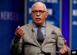 "FILE - Author Michael Wolff is pictured at the Newseum in Washington, April 12, 2017, as he moderates a conversation with presidential counselor Kellyanne Conway during a forum titled ""The President and the Press: The First Amendment in the First 100 Days."""