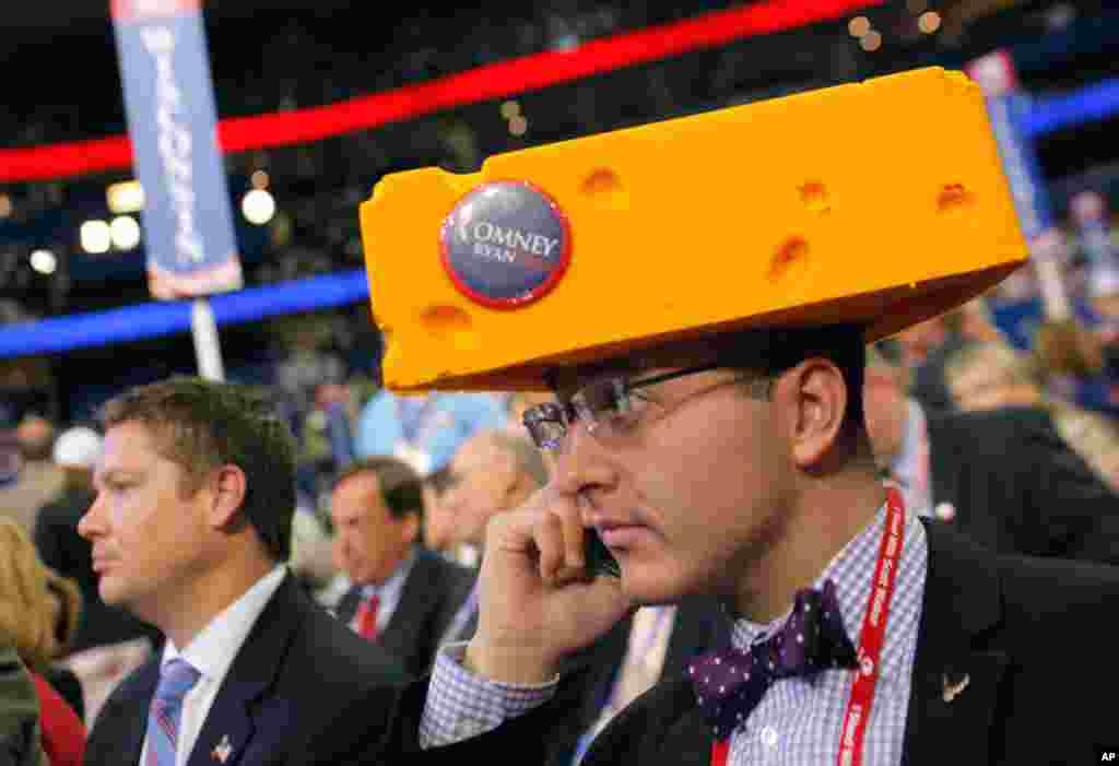 Delegate Sol Grosskopf from Shawano, Wisconisin wears cheesehead hat on the convention floor.