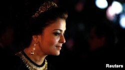 "Indian actress Aishwarya Rai poses as she arrives at the evening's gala of the film ""Bombay Talkies"" celebrating a hundred years of Indian cinema, during the 66th Cannes Film Festival in Cannes May 19, 2013."