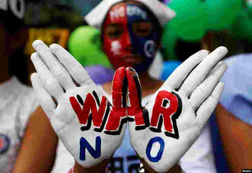 A girl with painted hands and face participates in a peace rally to commemorate the 73rd anniversary of the world's first atomic bombing in the Japanese city of Hiroshima during World War 2, in Mumbai, India.