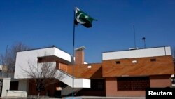 FILE - A Pakistani flag waves at the Pakistani embassy in Kabul.