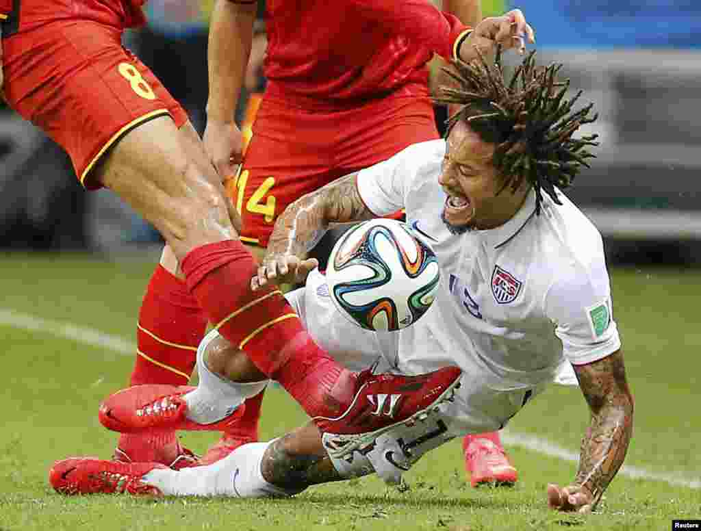 Belgium's Marouane Fellaini kicks the ball near Jermaine Jones of the U.S. during the 2014 World Cup round of 16 game at Fonte Nova arena in Salvador, Brazil, July 1, 2014. Belgium won the match 2-1.