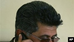 Razaq Mamoon, an Afghan journalist and author, speaks on his mobile phone at his office in Kabul, Afghanistan (File Photo).