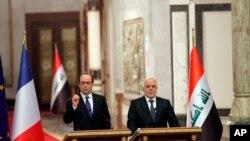 Francuski predsednik Fransoa Oland i irački premijer Hajder al-Abadi na konferenciji za novinare u Bagdadu