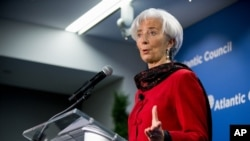 FILE - International Monetary Fund Managing Director Christine Lagarde speaks at the Atlantic Council, Washington, April 9, 2015.