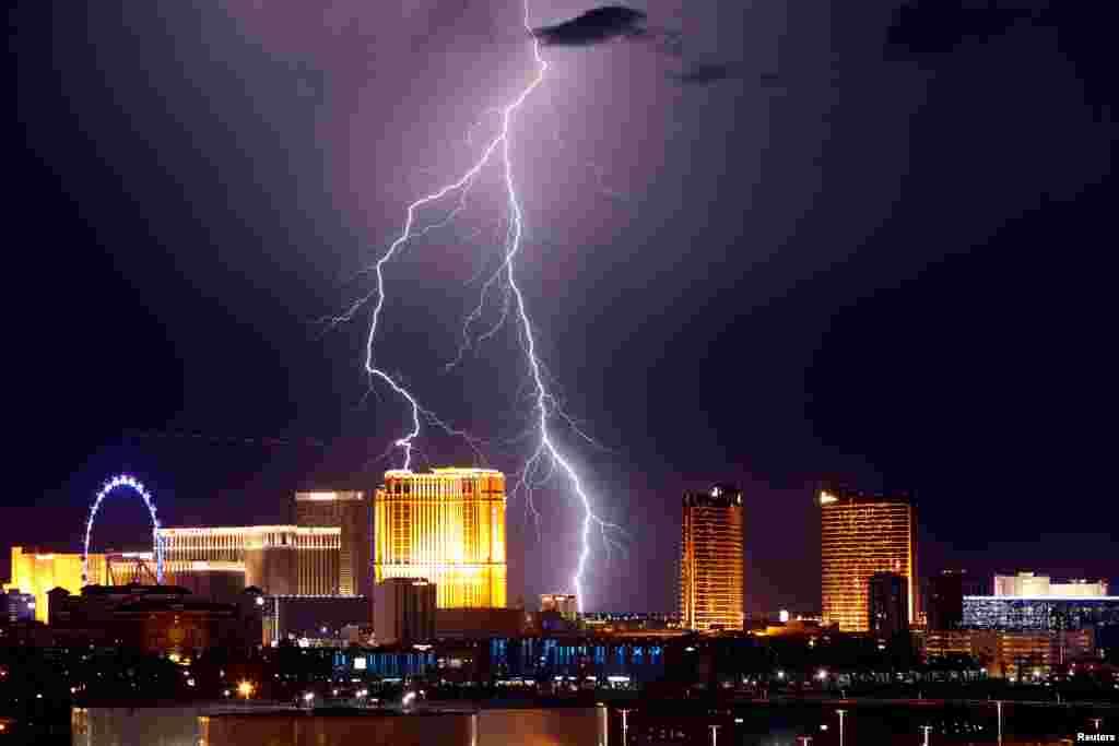 Lightning strikes behind Las Vegas Strip casinos as a thunderstorm passes through Las Vegas, Nevada, U.S. September 13, 2017.