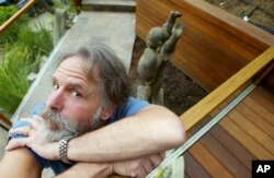 FILE - Bob Weir of the Grateful Dead poses for a photo outside his home in Mill Valley, California, April 15, 2004.