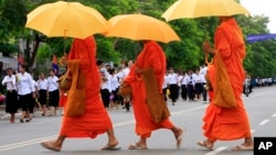Cambodian Buddhist monks walk by the crowd, file photo.
