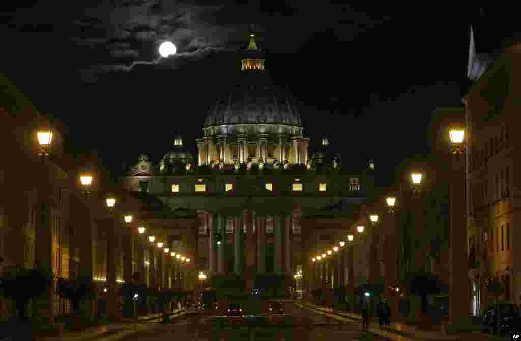 The full moon is seen above the St. Peter's Basilica at the Vatican.