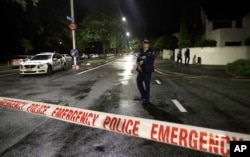 A police officer patrols at a cordon near a mosque in central Christchurch, New Zealand, March 15, 2019. Multiple people were killed in mass shootings at two mosques full of worshipers attending Friday prayers.