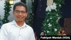 Pastor Paroki Santa Clara Raymundus Sianipar di Bekasi, 24 Desember 2019. (Foto: Fathiyah Wardah/VOA)