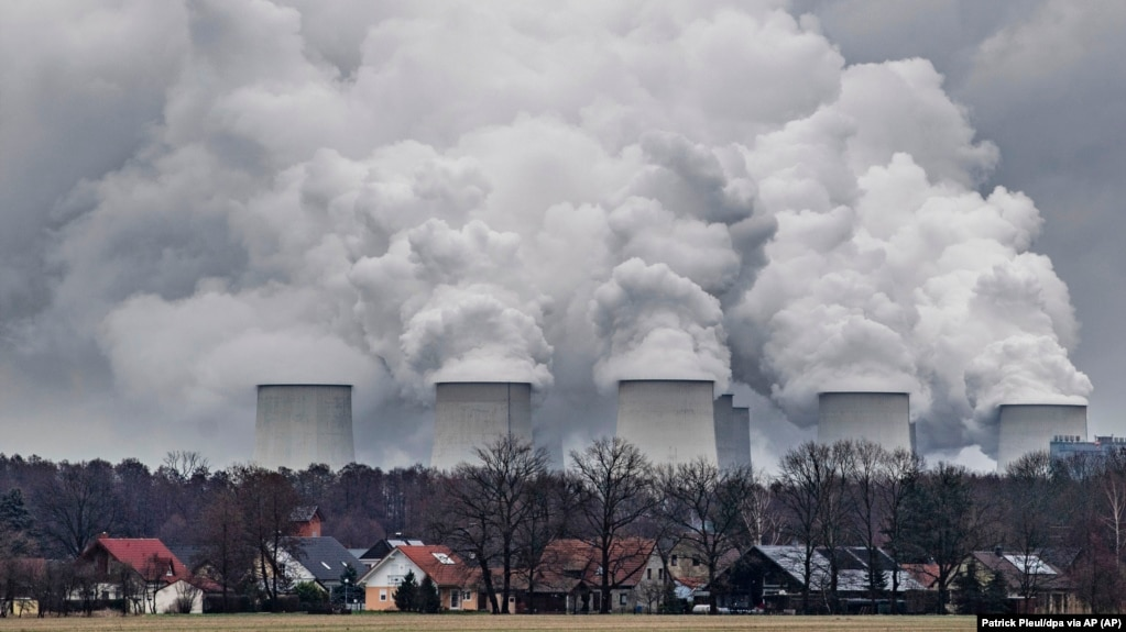 In this January 6, 2019 file photo water vapor rises from the cooling towers of the Joenschwalde coal-fired power plant of Lausitz Energie Bergbau AG (LEAG) in Brandenburg, Germany. (Patrick Pleul/dpa via AP)