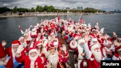 People dressed as Santa Claus take part in the World Santa Claus Congress, an annual event held every summer in Copenhagen, Denmark, July 23, 2018.