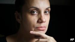 Saturnina Plasencia, 43, at her home in New York on Monday Oct. 1, 2018. (AP Photo/Bebeto Matthews)