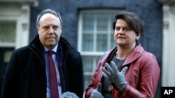 DUP Party leader Arlene Foster and Deputy Leader Nigel Dodds, left, make a statement to the media after exiting 10 Downing Street. London, Jan. 17, 2019. British Prime Minister Theresa May is reaching out to opposition parties and other lawmakers to put Brexit back on track.
