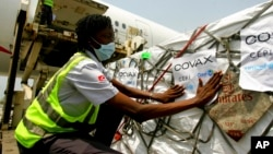 FILE - A shipment of COVID-19 vaccines distributed by the COVAX global initiative arrives in Abidjan, Ivory Coast, Feb. 25, 2021.