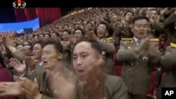 Image made from undated video of a news bulletin aired by North Korea's KRT on July 10, 2017, shows soldiers applauding N, Korea's leader Kim Jong Un in Pyongyang for the successful launch of his country's first intercontinental ballistic missile.