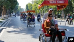Chinese tourists ride rickshaws for sightseeing in Hanoi, Vietnam. The number of Chinese tourists visiting Vietnam has increased in recent years.