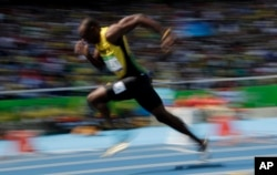 Jamaica's Usain Bolt competes in a men's 200-meter heat during the athletics competitions of the 2016 Summer Olympics at the Olympic stadium in Rio de Janeiro, Brazil, Aug. 16, 2016.
