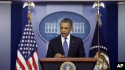President Barack Obama speaks to reporters in the Brady Press Briefing Room at the White House in Washington after meeting with Congressional leaders regarding the fiscal cliff, December 28, 2012.