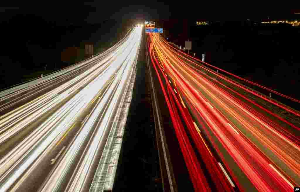 Traffic runs as usual on a highway in Frankfurt, Germany.