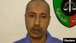 리비아의 전 독재자 무아마르 가다피의 아들 사디. 리비아 정부는 6일 삭발하고 죄수복을 입은 사디의 사진을 공개했다.