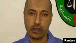 Sa'ad Gaddafi a gidan kaso a birni Tripoli bayan da aka mika shi ga hukumar kasar Libya.