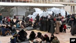 Displaced Syrian families take refuge near Damascus in Feb. 23, 2015
