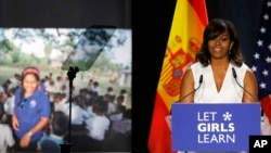"""U.S. first lady Michelle Obama gives a speech as part of her """"Let Girls Learn"""" initiative to a group of girls and young women in Madrid, Spain, June 30, 2016."""