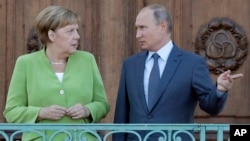 Almanya Başbakanı Angela Merkel ve Rusya Lideri Vladimir Putin.