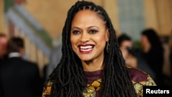 "FILE - Director and executive producer Ava DuVernay poses at a screening of the film ""Selma"" during AFI Fest 2014 in Hollywood, California, Nov. 11, 2014."