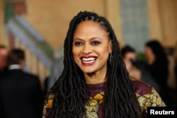 """FILE - Director and executive producer Ava DuVernay poses at a screening of the film """"Selma"""" during AFI Fest 2014 in Hollywood, California, Nov. 11, 2014."""