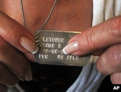 "Dorine Kenney always wears her late son's ""dog tag"" military ID"