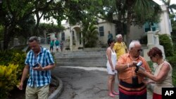 Tourists walk around the home that once belonged to author Ernest Hemingway, known as Finca Vigia, in Havana, Cuba, June 22, 2015.