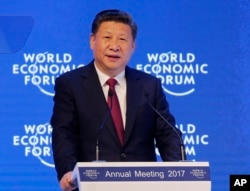 FILE - China's President Xi Jinping speaks at the World Economic Forum in Davos, Switzerland, Jan. 17, 2017.