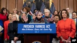 Rep. Rosa DeLauro, D-Conn., sponsor of the Paycheck Fairness Act, center, flanked by Lilly Ledbetter, left, an activist for workplace equality, and Speaker of the House Nancy Pelosi, D-Calif., speaks at the Capitol in Washington, Jan. 30, 2019.
