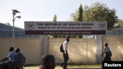 People pass by the Ministry of Petroleum and Mining in Juba, November 7, 2012.