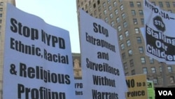 Signs carried by protesters call for end to spying.